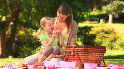 Mother and her daughter eating watermelon Stock Video Footage