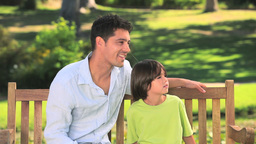 Father and son chatting outdoors Stock Video Footage
