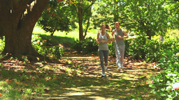 Athletic couple jogging in the wood Footage