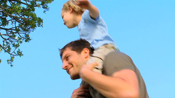 Son on his fathers shoulders Stock Video Footage