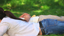Couple lying on the grass Stock Video Footage