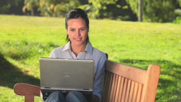 Young womann using a laptop outdoors Stock Video Footage