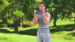 Handsome male doing musculation exercises Footage