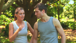 Couple taking a break while jogging Stock Video Footage