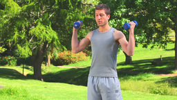 Dynamic man with dumbbells Stock Video Footage