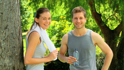 Couple resting after a run Stock Video Footage
