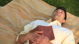 Handsome man sleeping outdoors Footage