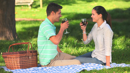 Couple drinking red wine outdoors Footage