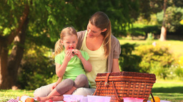 Mother and daughter eating watermelon Footage