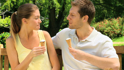 Loving couple enjoying ice cream outdoors Stock Video Footage