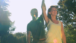 Loving couple dancing outdoors Footage