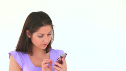 Young woman writing a message on her mobile Footage