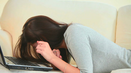 Young woman laughing with her laptop Stock Video Footage