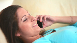 Young woman having a phone conversation Stock Video Footage