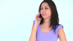 Young woman talking on the phone Footage
