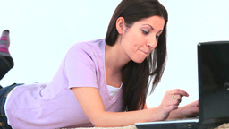 Young woman using her laptop Footage
