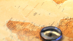 Worldmap and a compass rotating Stock Video Footage