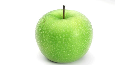 Wet green apple rotating Footage