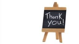 Phrase Thank you written on a blackboard Stock Video Footage