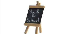 Phrase Back to school written on a blackboard Stock Video Footage
