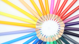 Color pencils joined at the top turning Stock Video Footage