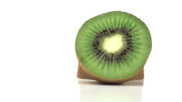 Split kiwi fruit rotating Stock Video Footage