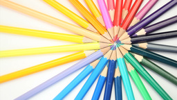 Color pencils joined at the top turning Footage