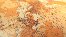 Compass on a map of the world rotating Stock Video Footage
