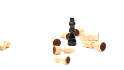 Chess pieces fallen around the king Footage