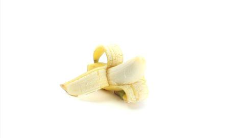 Half peeled banana rotating Stock Video Footage