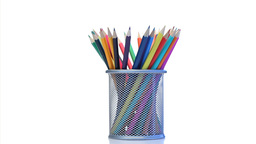 Color pencils rotating in a pencil holder Footage