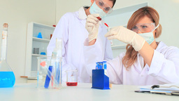 Scientist women carrying out an experiment Stock Video Footage
