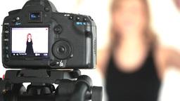 Camera taking shot of blonde woman posing Footage
