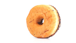 Donut with chocolate icing rotating Footage