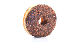 Donut with chocolate icing rotating Stock Video Footage