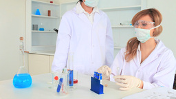 Scientists carrying out an experiment Footage