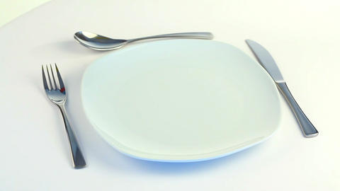 Plate, fork, knife and spoon turning Footage