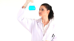 Scientist woman looking at a flask Footage