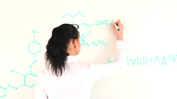 Scientist woman writting a formula on a whiteboard Footage