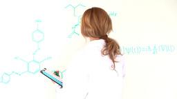 Scientist woman writing a formula Footage
