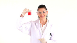 Scientist looking at a flask of red fluid Stock Video Footage