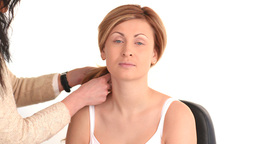 Young woman having her hair done by a hairdresser Stock Video Footage