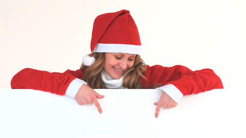 Young blonde woman dressed up as Santa Claus Footage