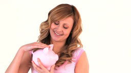 Cute woman posing with a piggy bank Stock Video Footage