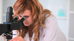 Scientist looking through a microscope Stock Video Footage