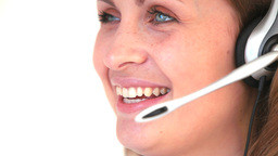 Young woman talking into a headset Stock Video Footage