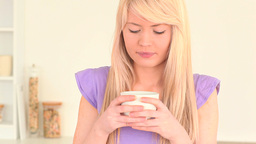 Attractive woman drinking coffee Stock Video Footage