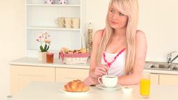 Young attractive woman having her breakfast Stock Video Footage