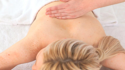 Young blondhaired woman having a massage Stock Video Footage
