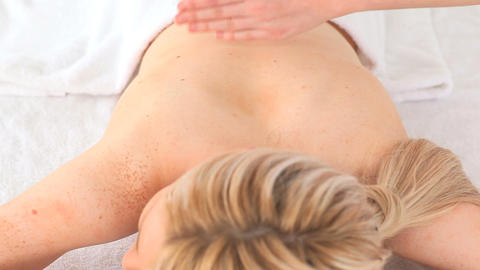 Young blondhaired woman having a massage Footage